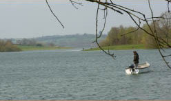 Bewl Water fishing man fly fishing close to Bedgebury camping