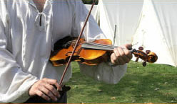 camping music of man with violin at camping ground
