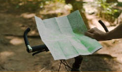 mountain biking whilst reading directions map